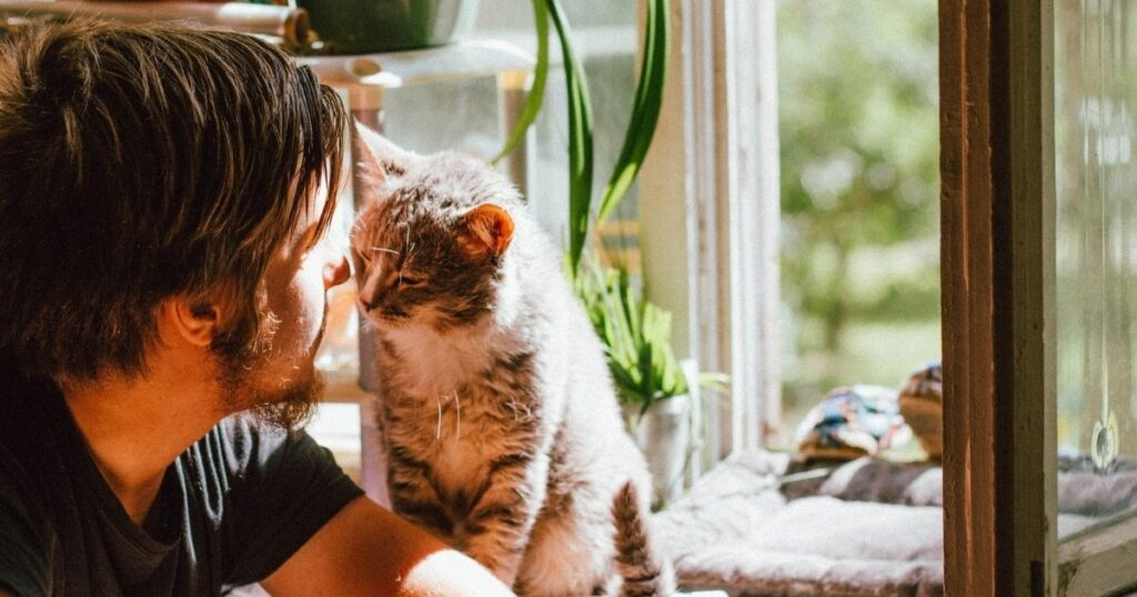 A man with his cat